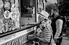 Icecream Time (gwpics) Tags: festival icecream england people eastleigh streetphotography english culture hat pride celebration british leisure woman greatbritain mono uk britishisles britain editorial everydaylife female hampshire hants lady lifestyle monochrome person socialcomment socialdocumentary society streetscene streetphotos streetpics unitedkingdom bw blackwhite blackandwhite street streetlife