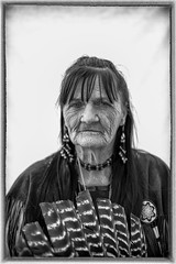First Nation Portrait (Rudy Malmquist) Tags: native american firstnation woman elder portrait face girl west michigan grand rapids powwow feathers wrinkles wrinkled weathered beads bw black white wanda