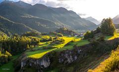 enjoying the sun.... (Rolf Enderes) Tags: che engadin tarasp ardez kantongraubünden schweiz ch grisons mountains sun sunset grass wood trees