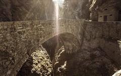 Bridge back to the roots (PeterThoeny) Tags: viamala zillisreischen zillis switzerland gorge ravine canyon rock tree bridge old oldbridge stonebridge day lensflare sun sunray ray light nex6 selp1650 3xp raw photomatix hdr qualityhdr qualityhdrphotography fav200