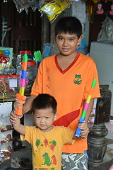 boys and swords (the foreign photographer - ฝรั่งถ่) Tags: two boys swords convenience store khlong lard phrao bangkhen bangkok thailand nikon d3200