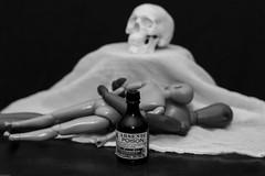 Romeo and Juliette (N.the.Kudzu) Tags: tabletop stilllife wooden plastic mannequin skull poison bottle bw canondslr canoneflens lightroom