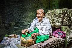 2015 Siem Reap (paulcore8118) Tags: nun temple ruins angkor wat siem reap cambodia prayer old lady