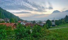 Kiefersfelden at dawn in Bavaria, Germany (UweBKK (α 77 on )) Tags: dawn sun sunrise sky clouds morning early panorama city mountains hills green kiefersfelden bavaria bayern germany deutschland europe europa iphone