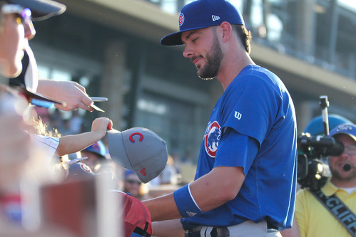 Kris Bryant signing autographs during his rehab assignment against Omaha
