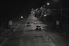 Uber 'neath a bridge in town, ein Mensch Joaquin I saw (Dimi Sahn) Tags: uber neath bridge town ein mensch joaquin i saw night street road tree black white monochrome motion nikon 100mm cityscape city urban suburban high elevated grain noise cars lights