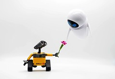 Hovering, Hovering, Hovering Heights. Evey It's Me, I'm Wall-E, Come Down Now (Skyline:)) Tags: flickrfriday hover walle smile eyes yellow whitebackground flower pink minifigures