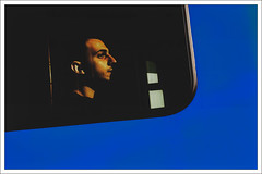 the eye, the ear, the nose, the window (Armin Fuchs) Tags: arminfuchs würzburg man street passenger blue tram afternoonlight niftyfifty window