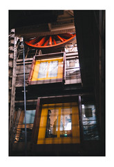 Dark Elevation (Thomas Listl) Tags: thomaslistl color paris france wheel red yellow people street urban elevator eiffeltower latoureiffel layer windows cabin dark mood ngc