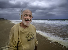 Man on the Beach During Storm. (crabsandbeer (Kevin Moore)) Tags: oc rehoboth easternshore ocean oceancity people rain sky stilllife storm waves weather clouds candid portrait street hurricane wind smile