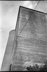 storage silos, cement, working waterfront, Rockland, Maine, Olympus XA4, Kodak TMAX 400, Kodak TMAX developer, 8.28.18 (steve aimone) Tags: silo silos storage cement architecture architecturalforms workingharbor rockland maine olympus xa4 olympusxa4 kodaktmax400 kodaktmaxdeveloper compactcamera 35mm 35mmfilm film blackandwhite monochrome monochromatic