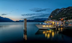 taxi boat to be cleaned before sunrise (juhwie.foto - PROJECT: LEIDENSCHAFT-LICH-T) Tags: ship boat bluehour before sunrise dawn lake como lago di lombardia italy lights water sea calm menaggio landscape seascape mountains longexposure longtime pentax k1 ricohimaging haida haidafilters reflection