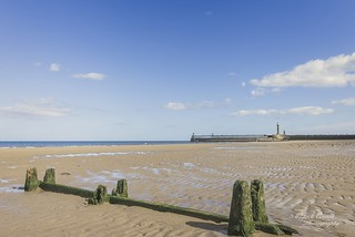 Whitby beach with breakwater and pier.