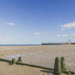 Whitby beach with breakwater and pier. thumbnail