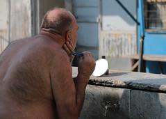 Mirror (Dragan*) Tags: people man mirror shaving faucet water outdoor