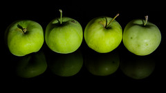*** (donnicky) Tags: apple blackbackground closeup four fruit green inarow publicsec reflection repeatingelements