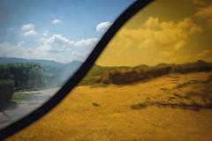 La vista dalla Cappella del Barolo. (Matt_Briston) Tags: fujifilm x70 italy piemonte barolo ceretto lamorra stainedglass chapel davidtremlett yellow blue