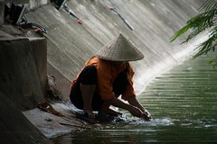 Washing shoes in the river (aniawagner) Tags: shoes washing canal river hanoi atmoshere vietnam green orange