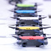 Row of DJI Spark drones of different colors