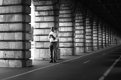 Consulting his smartphone (pascalcolin1) Tags: paris13 homme man bercy pontdebercy bridge lumière light photoderue streetview urbanarte noiretblanc blackandwhite 5omm canon50mm canon