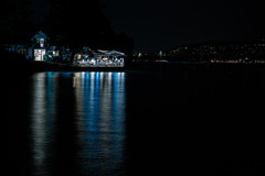 Ruschlikon Reflections (T Ironman) Tags: rueschlikon switzerland swiss lights citylights reflections bluewater bluelights restaurant water waterfront goodtimes umbrella umbrellas zurich europe night nightshots mights longexposure lake lakezurich lakes