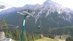 Scenic Ride on the Mt. Norquay Chairlift in Banff (lhboudreau) Tags: mtnorquay norquay mountain mountains banff alberta canada chairlift mountnorquay outdoor outdoors scenery scenicride tree trees pine pines pinetree pinetrees landscape canadianrockies rockymountains rockies resort video videos mountainside wood forest sky grass