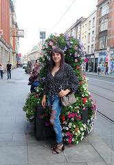 Dublin walk 5 (eileen_cd) Tags: flowers jeans ripped highheels polkadotblouse shoulderbag outside dublin standing crossdresser cd transvestite tv