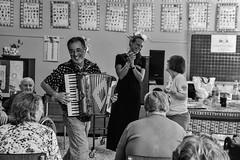 Istituto Giovanni XXIII (Claudia Celli Simi) Tags: istitutogiovannixxiii bw bn biancoenero blackandwhite monocromo monocrhome contrasto ritratti volti anziani vecchi viterbo facchinidisantarosa 2settembre musica cantare fisarmonica