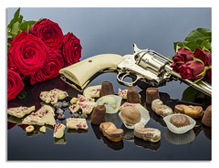 Guns and roses with chocolate. (johnhjic) Tags: johnhjic hasselblad x1d reflection reflections reflecting red rose roses gun hand broncolor studio strobe strobist siros stilllife chocolate chocolates green flower