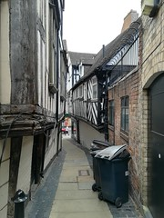 Fish Street (daveandlyn1) Tags: shrewsbury passageway buildings blackandwhitetimberframe pralx1 p8lite2017 huawei smartphone cameraphone wheeliebin pavingslabs person slope downhill gropelane