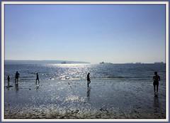 The Joy of Wading (FernShade) Tags: vancouverbc secondbeach seashore beach ocean sea westcoast pacificnorthwest wading coast coastal outdoor sky water