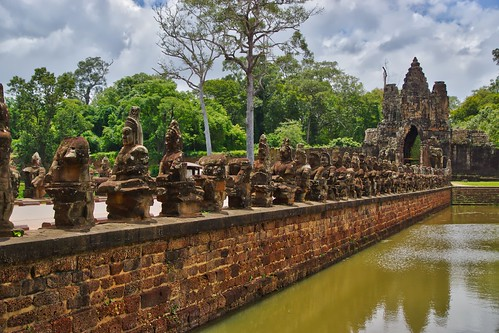 Causeway crossing the moat to the Southern portal of the ancient city of Angkor Thom near Siem Reap, Cambodia