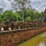 Causeway crossing the moat to the Southern portal of the ancient city of Angkor Thom near Siem Reap, Cambodia thumbnail
