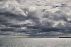 Distant rain (chairman.bill) Tags: torbay devon clouds sea boat yacht rain sun