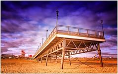 Piers End... (Sean....) Tags: coastal coast sea atmosphere atmospheric clouds fairground sand structure walk amusements seaside pier beach holiday holidays