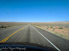 Southbound with the San Rafael Reef on the right on Scenic Route 24, Utah (Andrea Meyers) Tags: highdesert utah emerycounty navajosandstone wingatesandstone driveby route24