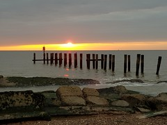 Sunrise from Lowestoft Suffolk uk today (madmax557) Tags: sunrise lowestoft uk england earlymorning eastanglia reflections northsea greatbritain suffolk eastcoast outwalking outdoors thegreatoutdoors outandabout outside mobilephone samsungphone bythesea rocks seawall seadefence posts samsung