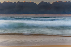 Unde the Cloudbank Sunrise Seascape (Merrillie) Tags: daybreak sunrise cloudy australia nsw centralcoast clouds sea newsouthwales rocks earlymorning morning water landscape ocean nature sky waterscape coastal seascape outdoors killcarebeach dawn coast killcare waves