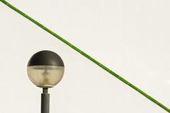 Lamp en green handrail (Jan van der Wolf) Tags: map18197ve handrail leuning diagonaal diagonal fuerteventura lamp light blulb minimalism minimalistic minimalisme minimal minimlistic geometric geometry geometrisch bulblight bollamp bulblamp