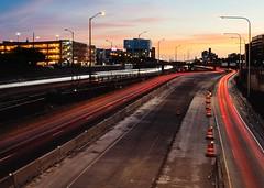 Sunset Trails (BlinkOfALens) Tags: chicago us illinois sunset traffic highway lighttrails construction