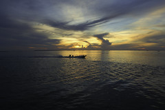 a fisherman (tanongsak.s) Tags: thailand boat fisherman sea seascape landscape morning skyline sky clouds sunset sunrise sunlight sunny colorful nature environment dramatic