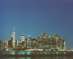 Late Nights on Governors Island (GPhace) Tags: 120mm 127mm governersisland kodak longexposure mamiya manhattan mediumformat nyc newyorkcity portra400 rb67pros sekor skyline worldtradecenter cityscape financialdistrict nightphotography thebattery twilight