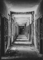 The Corridor Of Abandonment (panos_adgr) Tags: nikon d7200 monochrome bw abandoned hotel radion kamena vourla greece travel photography building architecture doors windows ambient light textures wall view