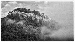 Königstein, fortress in the fog (unukorno) Tags: festungkönigstein sächsischeschweiz fortress fog mist sw bw monochrome nebel frame noise grain morning morgenstimmung clouds wolken trees