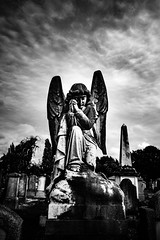 Full circle (Kieron Ellis) Tags: statue grave graveyard gravestone angel sky clouds street blackandwhite blackwhite monochrome kneeling praying