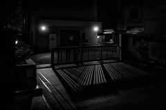 kawasaki-4634-ps-w (pw-pix) Tags: night dark lights shadows gate driveway entry exit garden wall paving paved plants bushes shrubs bikes bicycles buildings carpark bw blackandwhite monochrome kawasakifirestation daichikeihinroad daichikeihin minamimachi kawasaki kanagawa japan peterwilliams pwpix wwwpwpixstudio pwpixstudio