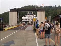 Bowen Island Ferry Dock BC18h34 LG (CanadaGood) Tags: canada bc britishcolumbia bowenisland bcferries ferry sea howesound people person shore dock sign tree canadagood 2018 thisdecade color colour cameraphone