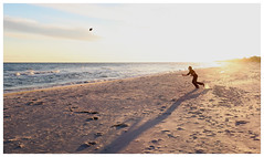 Chasing the Ball at Sunset - St. George Island, Florida (TravelsWithDan) Tags: candid sunset beach ocean gulfofmexico football playingcatch shadows island canong9x stgeorgeisland florida usa outdoors youngman motion action