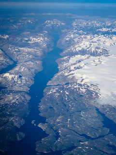 Aerial view of the coast and fjords of Greenland on flight from KEF to YUL