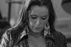 Lady in leather (Frank Fullard) Tags: frankfullard fullard lady leather earrings earings candid street portrait monochrome black white blanc noir beauty eyes style stylish buckle stud pearl fashion
